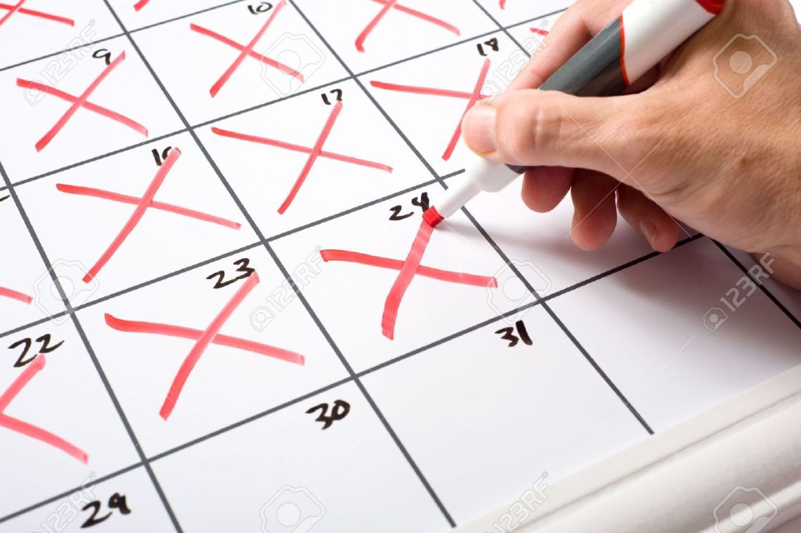 4722712-A-hand-holding-a-dry-erase-marker-x-ing-days-of-the-month-off-of-a-calendar-Passing-of-time-conecpt--Stock-Photo[1]