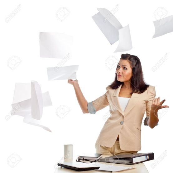 15086842-brunette-businesswoman-throwing-up-papers-in-the-air-Stock-Photo