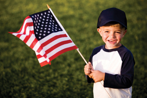child-holding-american-flag